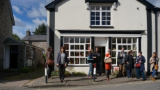 Visitors outside Glasfryn, Llangattock